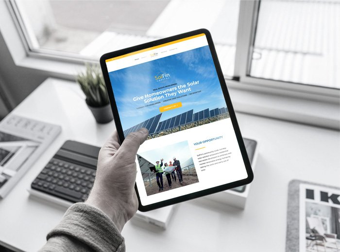 SolFin website mockup showing man holding iPad