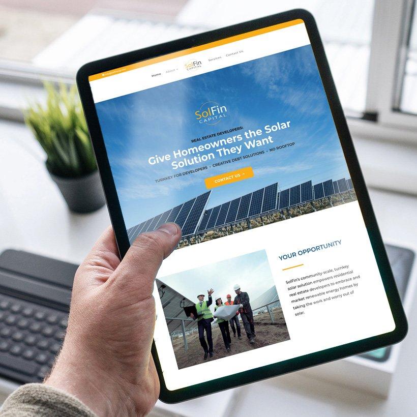 SolFin-mockup-man-holding-iPad-2